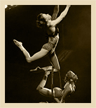 two aerialists performing